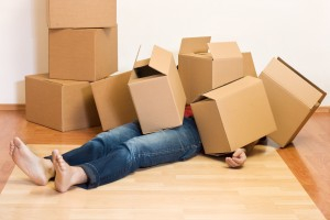 guy buried in moving boxes